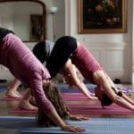 downward dog on advanced yoga retreats