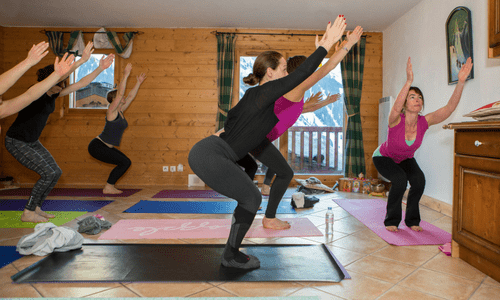chair pose in yoga studio france skiing and yoga holiday