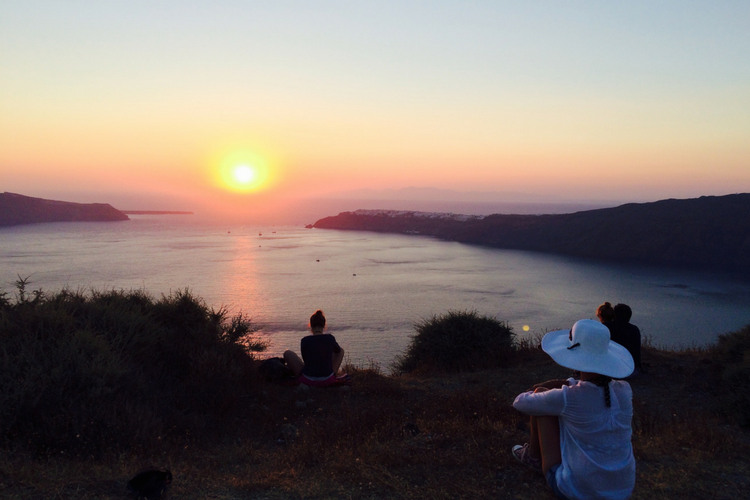 Guests Watching a Sunset in Santorini