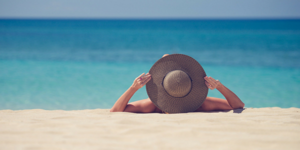 Woman wearing sun hat on beach