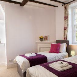 Twin bedroom thrupp yoga retreat venue