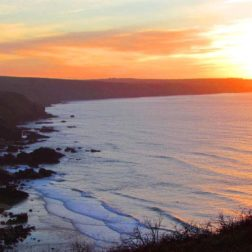 Sunset over beach cornwall