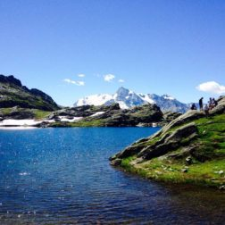 french alps glacial lake and ice capped mountain views