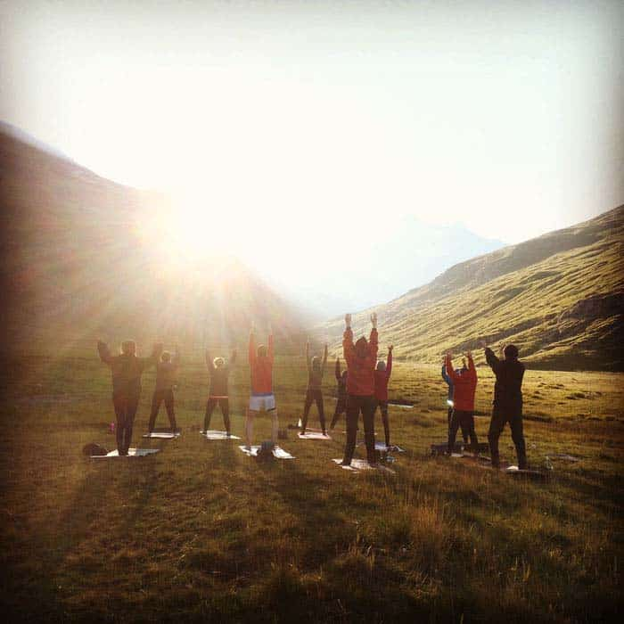 Morning sunrise yoga class people dong yoga whilst sun rises france