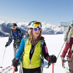 Guest laughing in ski gear on mountain yoga and skiing holiday