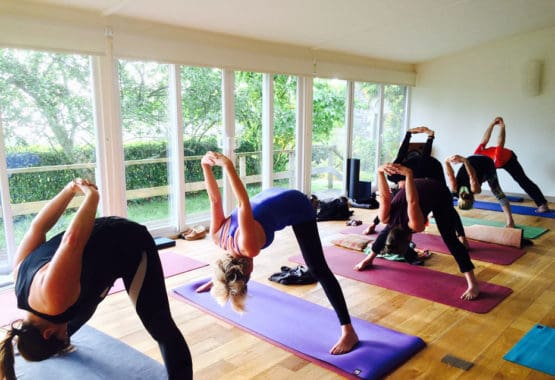 yoga class lake district wide legged forward fold