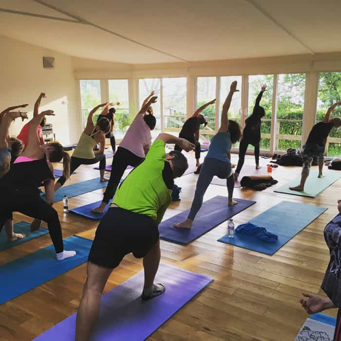 yoga class in yoga studio parsvarkonasana lake district