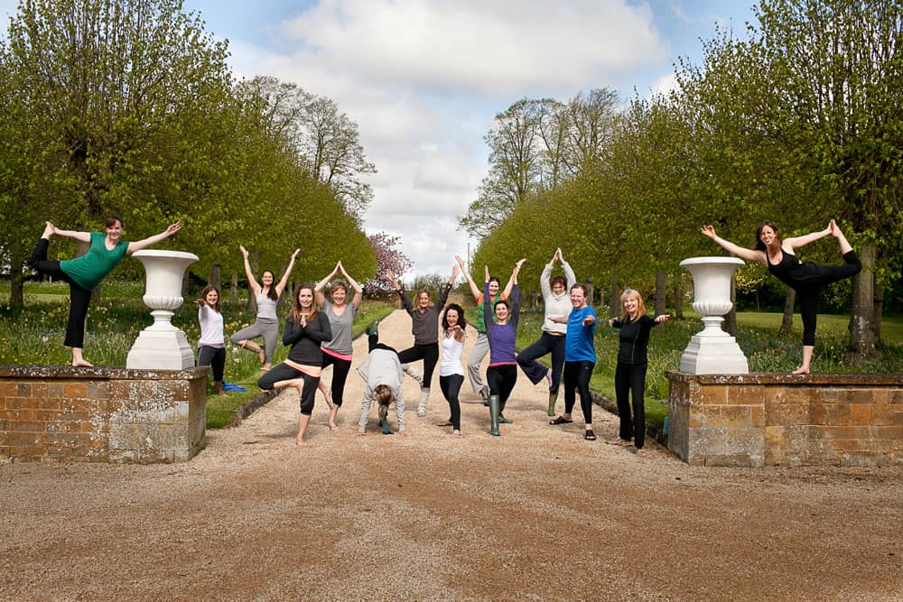 group yoga pose photo oxford yoga retreat outside