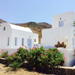 white washed dome roofed accommodation Santorini retreat venue