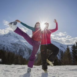 two guests yoga pose with sun behind them yoga and skiing holiday french alps