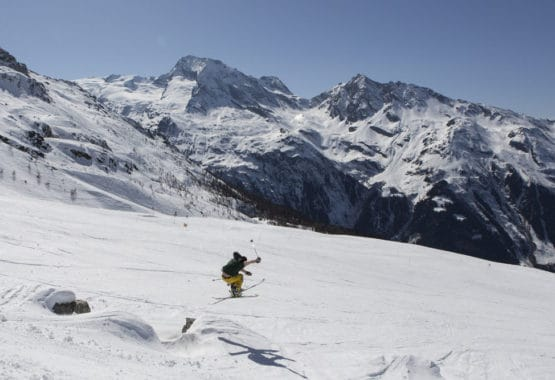 skier jumping over a jump French Alps
