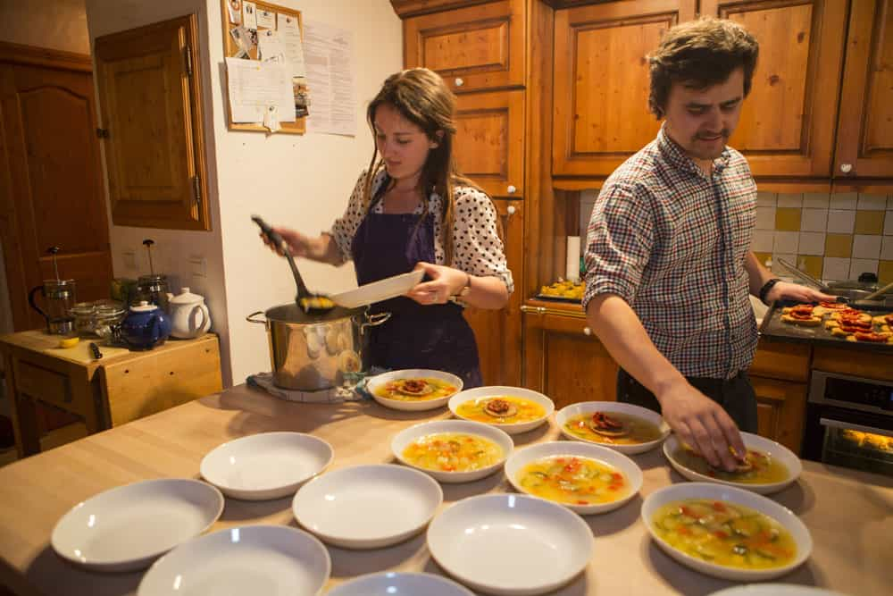 chalet staff serving up soup yoga and skiing holiday france