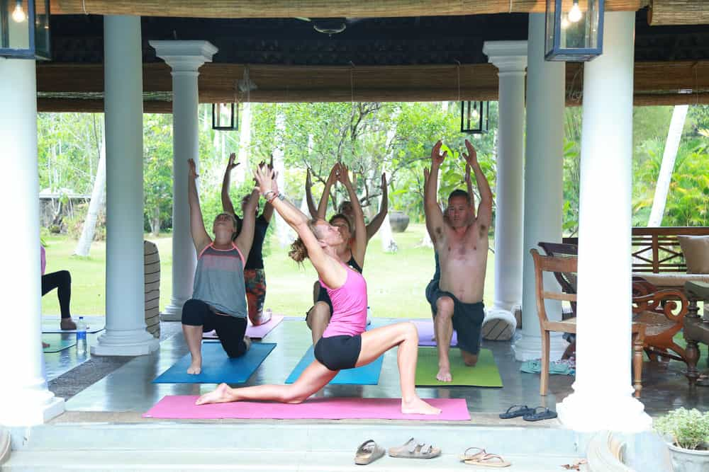 yoga class in pavilion with teacher and students