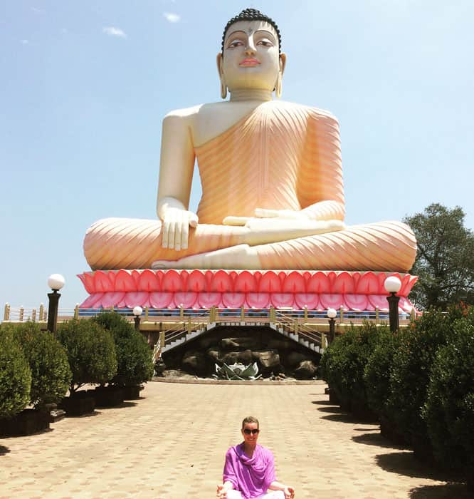 Big Buddha statue with guest sitting under