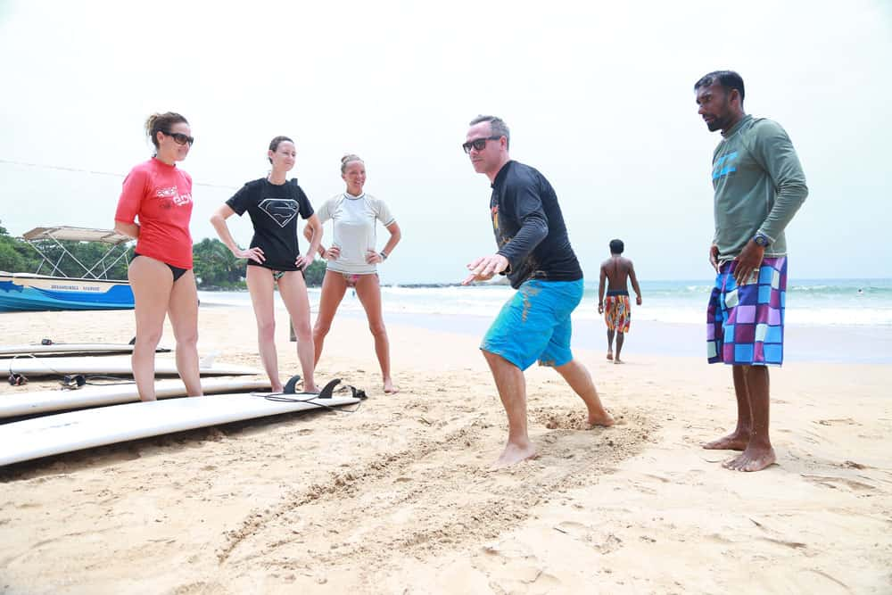 surf lesson on the beach bentota sri lanka