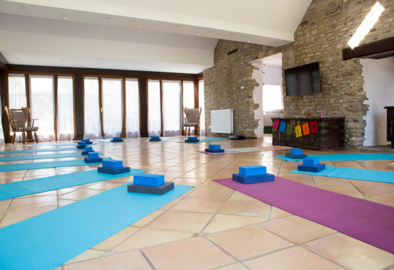 yoga space facing long windows mats on floor thrupp