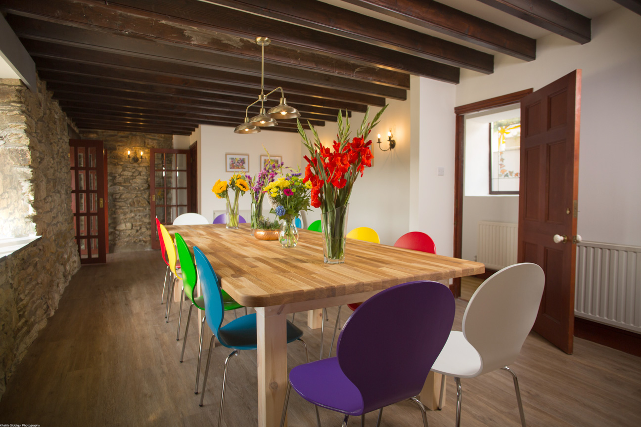 dining table and colourful chairs farmhouse cornwall