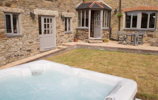 outside farmhouse hot tub