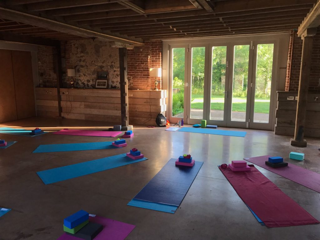 Yoga space with mats laid out yoga retreat norfolk