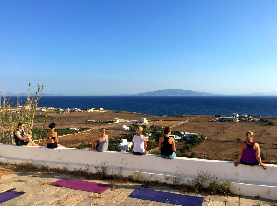 looking at the aegean sea after yoga sat on wall santorini
