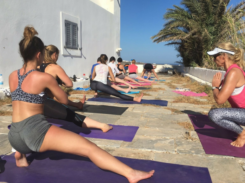 morning yoga by the church santorini sunshine and yoga holiday