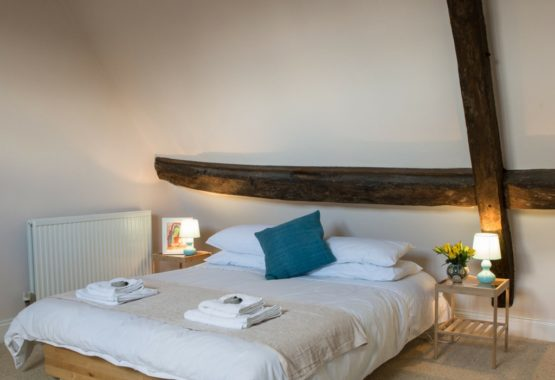low double bed with wood beams thrupp oxfordshire