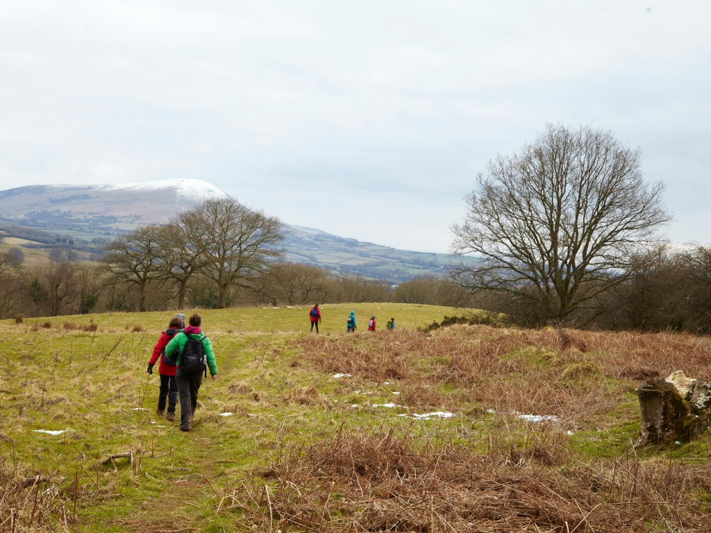 guests on hike brecon beacons wales new year retreat snowcapped mountains