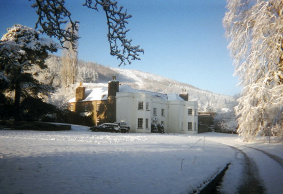 georgian manor house white with snow all around wales