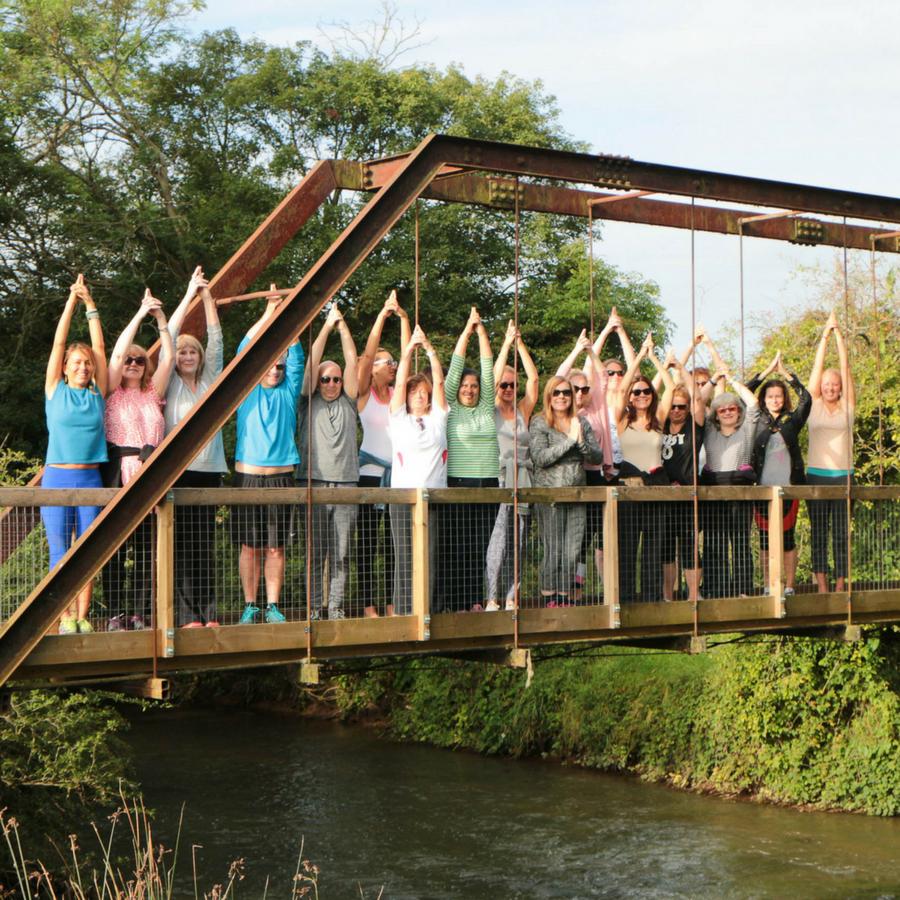 Group on Bridge in Thrupp summer yoga retreat