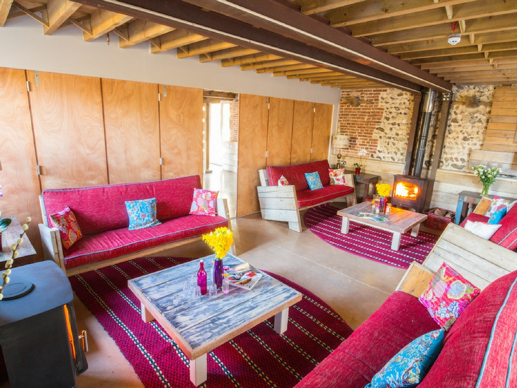 living area with sofas and wood burner - august bank holiday yoga retreat norfolk