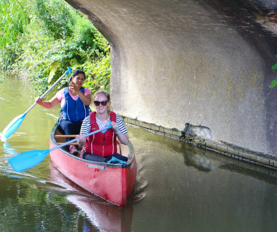two people in canoe on canal thrupp oxfordshire
