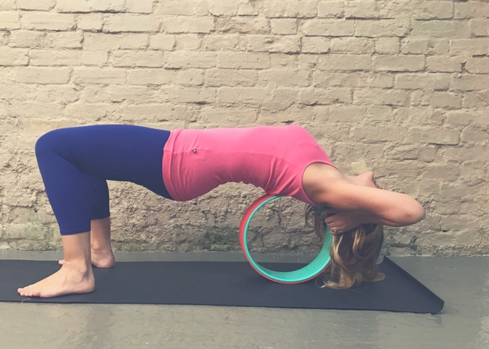 opening back with yoga wheel
