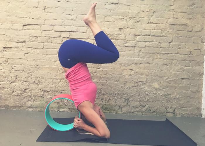 half headstand yoga wheel support