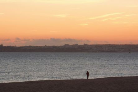 alone on beach sunset
