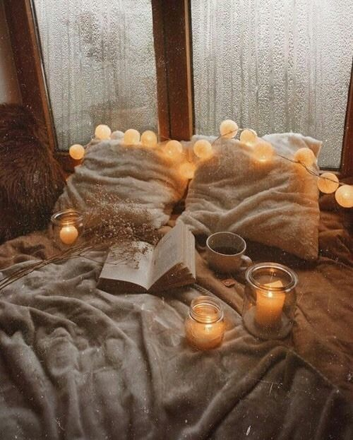 rejuvenate pillows by window with candles