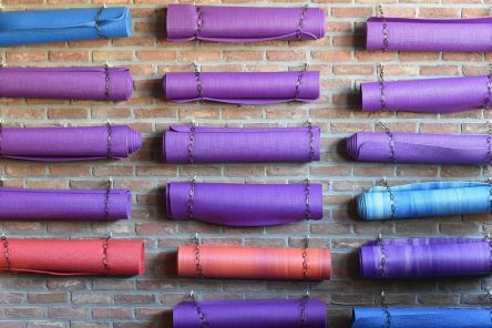 yoga mats hang on wall