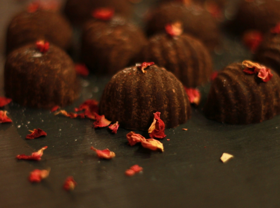 half moon shaped raw cacao chocolates with rose petals