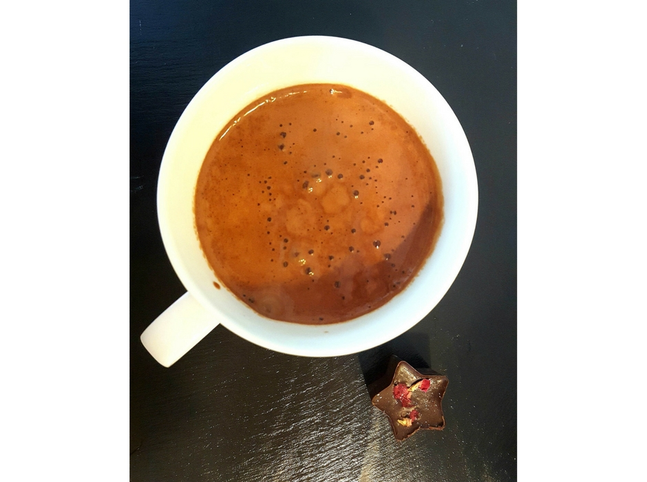 Raw cacao hot chocolate made in cup aerial view