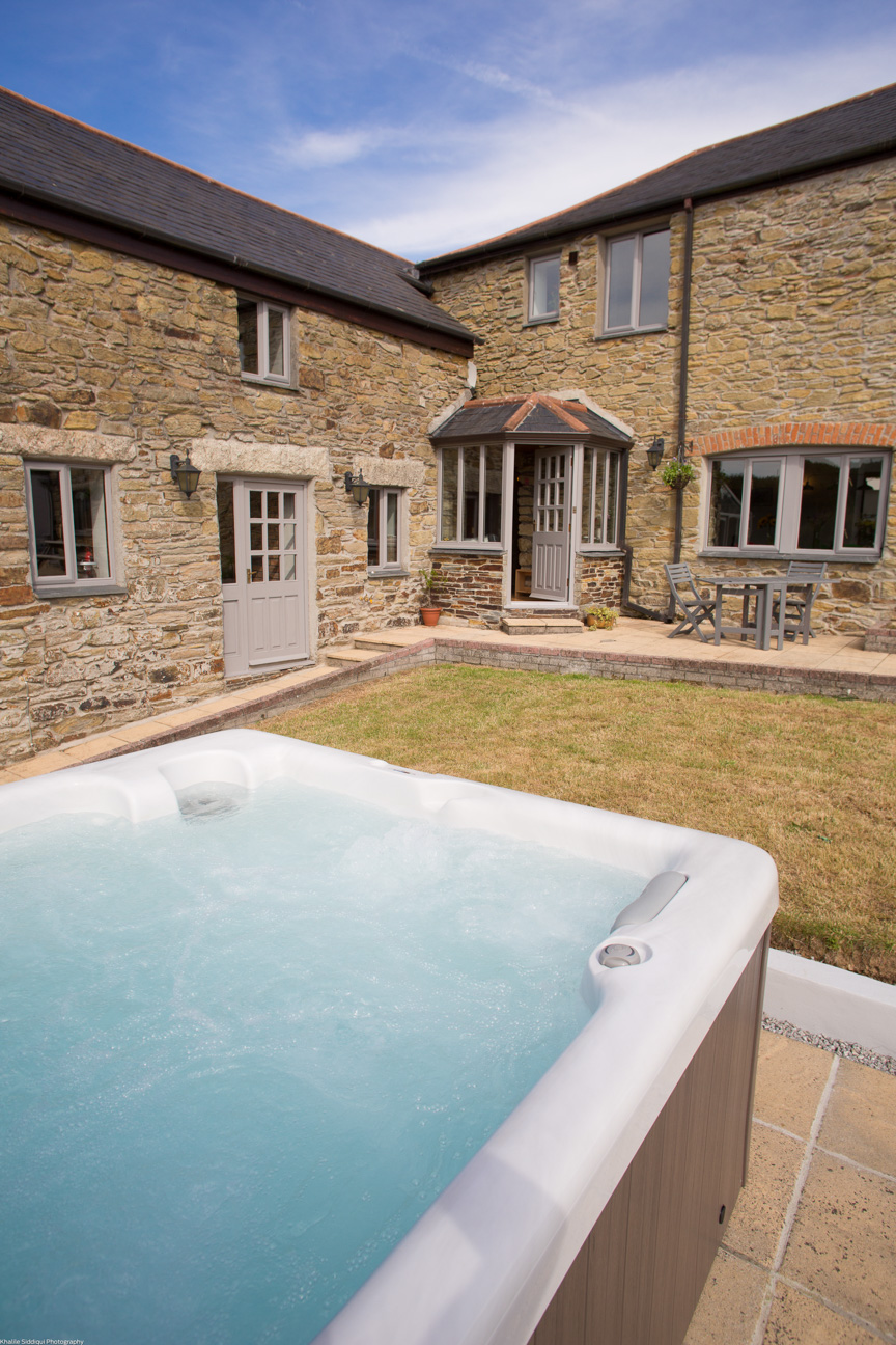 front of farmhouse outdoor hot tub