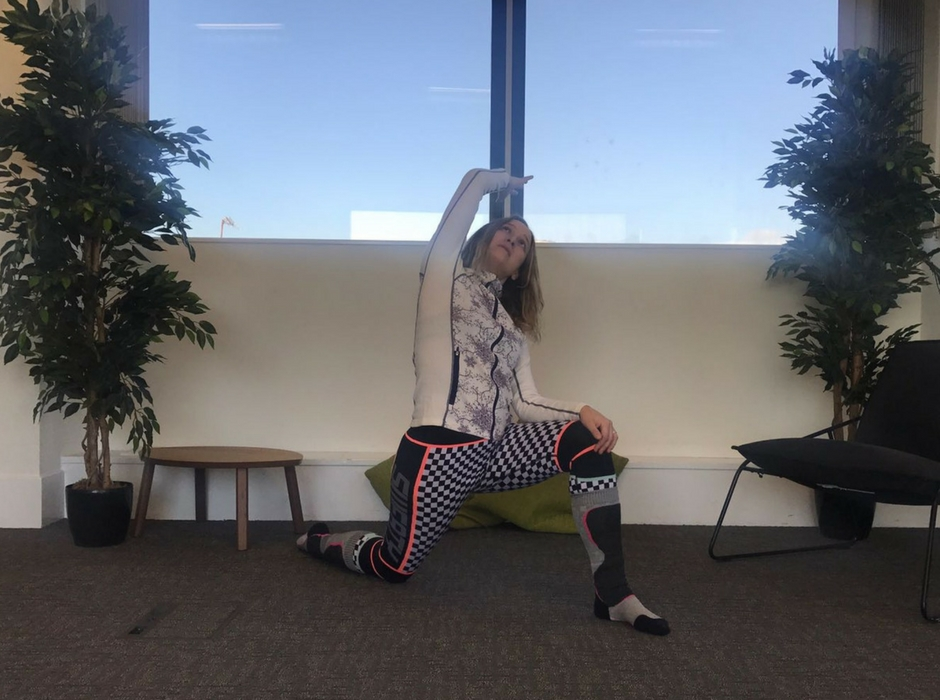 person doing lunge with side bend for post ski yoga
