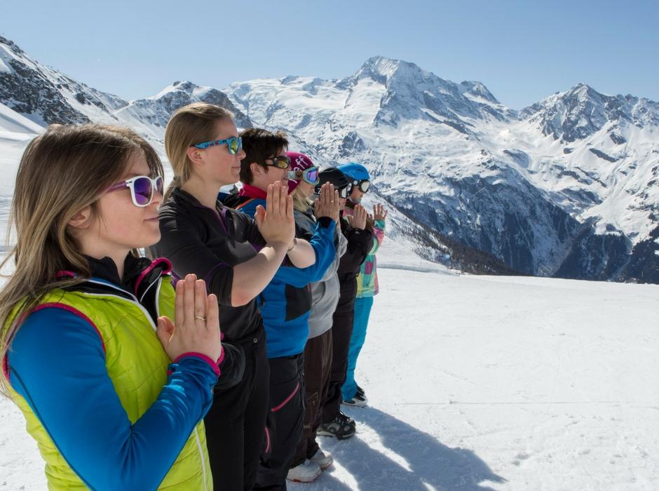 people in mountain pose on mountain ski area
