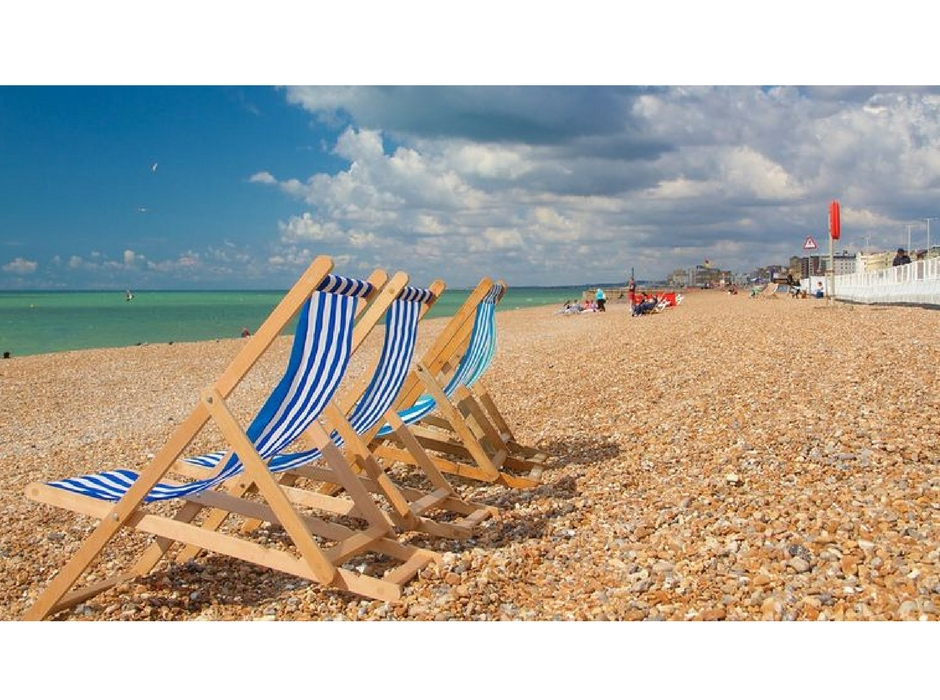 Brighton beach with deck chairs
