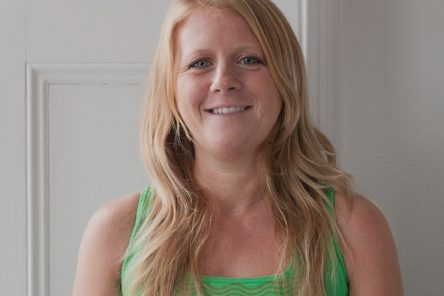 Yoga teacher Louise Windsor head shot against white backdrop