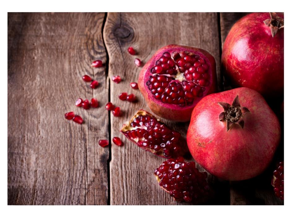 santorini pomegranate on wooden table