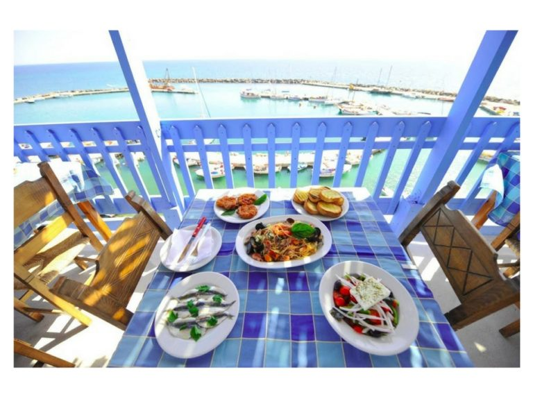 santorini taverna with for on table