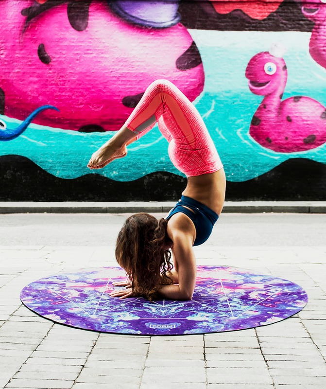 girl doing scorpion yoga pose on mat