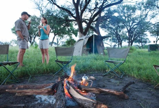tenet in bush lady and fire safari and yoga holiday