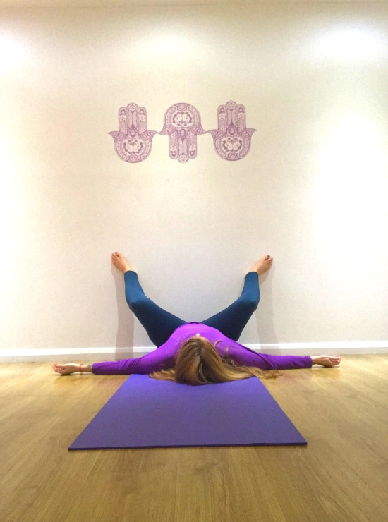squat legs up the wall yin yoga pose ease back pain