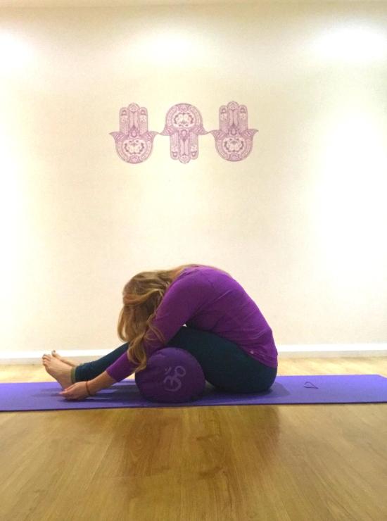 forward fold over bolster yin yoga pose ease back pain