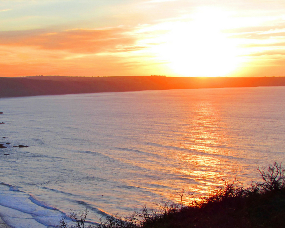 sunset over the sea cornwall